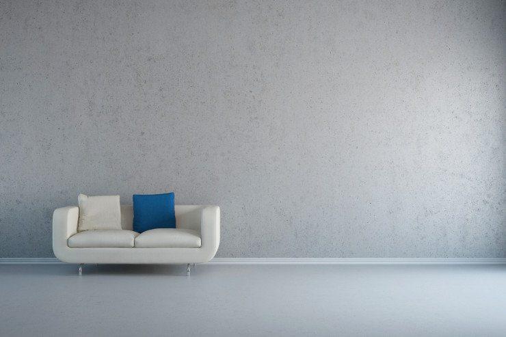 Ein zu kleines Sofa wirkt in einem grossen Wohnzimmer verloren. (Bild: © Robert Kneschke - Fotolia.com)
